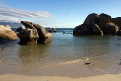 Boulders seascape and blue sky Stock Photo