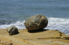 Boulders by the shore Stock Photo
