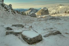 Boulders in the snow. Snow covered boulders in the high alpine Royalty Free Stock Photo