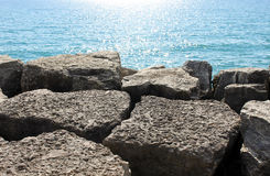Boulders and sparkling blue lake Royalty Free Stock Photos