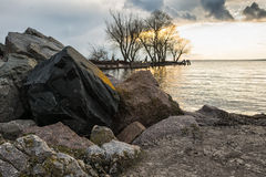 Boulders and stones on the river Bank. Boulders and stones on the river at sunset. Evening Royalty Free Stock Images
