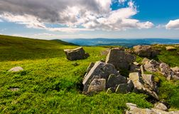 Boulders on top of Runa mountain. Beautiful landscape with distant peak under the cloud on a blue sky stock photography