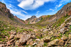 Boulders at top of small mountain valley Stock Photos
