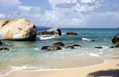 Boulders on tropical beach Stock Photography