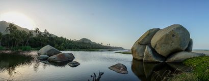 Boulders on Tropical Beach in Tayrona National Park, Colombia. stock images