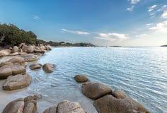 Boulders in a turquoise sea at Santa Giulia beach in Corsica Stock Photo