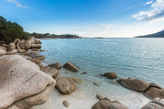 Boulders in a turquoise sea at Santa Giulia beach in Corsica Royalty Free Stock Image