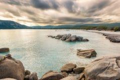 Boulders in a turquoise sea at Santa Giulia beach in Corsica Stock Photos