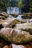 Boulders by the Waterfall Royalty Free Stock Image