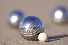 Boule on beach. Boule with a wooden Cochonnet on a sandy beach Royalty Free Stock Image
