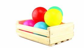 Boule colorée dans la boîte en bois Images libres de droits