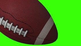 Boule de football am?ricain - plan rapproch? d'objet du sport 3D, vid?o anim?e sur l'?cran vert banque de vidéos