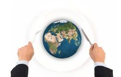 Boule de globe du monde avec la fourchette et couteau, éléments de cette fourrure d'image Image stock