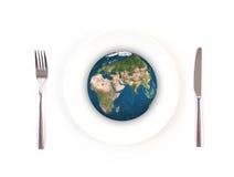 Boule de globe du monde avec la fourchette et couteau, éléments de cette fourrure d'image Images stock
