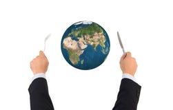 Boule de globe du monde avec la fourchette et couteau d'isolement, éléments de ceci Photographie stock
