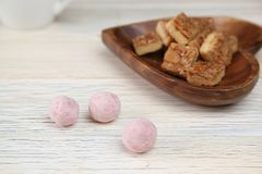 Boule de Neiges and Florentines in a wooden background. Pictured Boule de Neiges and Florentines in a wooden background stock photos