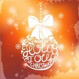 Boule de Noël avec le lettrage sur le fond brouillé Images stock