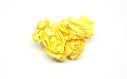 Boule de papier jaune chiffonnée Photos stock