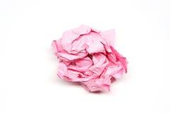 Boule de papier rose chiffonnée Photo stock