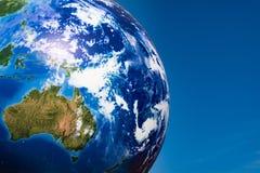 Boule de planète de concept de jour de terre au-dessus de ciel bleu photos stock