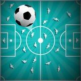 Boule du football au-dessus de fond de terrain de jeu Photographie stock
