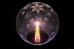 Boule en verre et faisceau lumineux Photo stock
