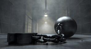 Boule et chaîne en prison photographie stock