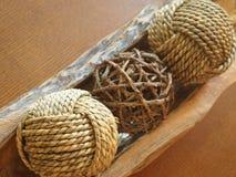 Boules avec la corde et la branche Images stock