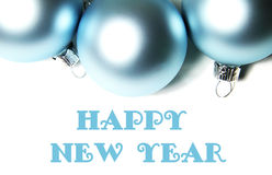 Boules bleues de Noël sur le fond blanc avec le texte image libre de droits