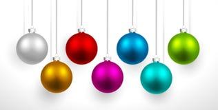 Boules colorées par Noël Photos stock