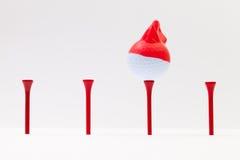 Boules de golf blanches avec le chapeau drôle Concept drôle de golf Photo libre de droits