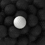 Boules de golf noires et blanches Photo stock