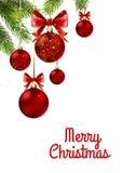 Boules de Noël avec le ruban et les arcs rouges Photographie stock