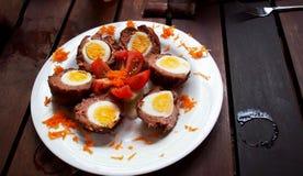 Boules de viande avec des oeufs Photographie stock libre de droits