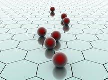Boules en céramique rouges sur la surface hexagonale Photographie stock libre de droits