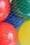 Boules en plastique colorées de macro fond Photos libres de droits