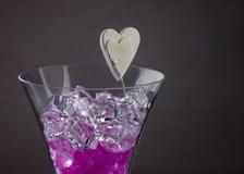 Boules en verre dans un verre de champagne Photos libres de droits