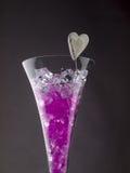 Boules en verre dans un verre de champagne Photos stock