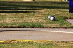 Boules mises par tir près de l'anneau de lancement Photos stock