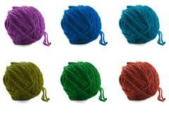 Boules multicolores de laine sur un blanc Photo libre de droits