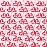 Boules rouges de coeurs sur le fond rose photo stock
