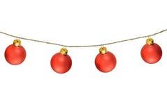 Boules rouges de Noël d'isolement sur le blanc Photographie stock libre de droits