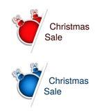 Boules rouges et bleues de Noël avec le label pour faire de la publicité le texte sur le fond blanc, autocollants avec l'ombre Images libres de droits