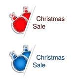 Boules rouges et bleues de Noël avec le label pour faire de la publicité le texte sur le fond blanc, autocollants avec l'ombre Photo stock