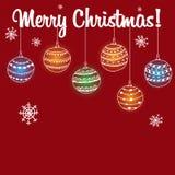 Boules uniques de carte de Noël sur un fond rouge Photographie stock
