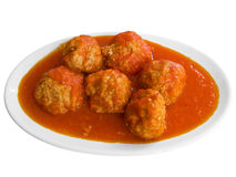 Boulettes de viande en sauce tomate sur le paraboloïde blanc. Photographie stock libre de droits