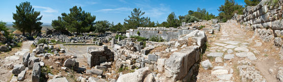 Bouleuterion panorama. Panorama of the ruins of the ancient Bouleuterion in the ancient Greek Ionian city of Priene (nowadays on the territory of Turkey Royalty Free Stock Image