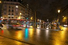 Boulevard of Clichy in the night. Paris,France-January 20, 2018: Wet Boulevard of Clichy in the night Royalty Free Stock Photography