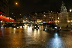 Boulevard of Clichy in the night. Paris,France-January 20, 2018: Wet Boulevard of Clichy in the night Royalty Free Stock Photos