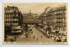 And Boulevard Denain in Paris, France. Antique french postcard of Northern Station and Boulevard Denain in Paris, France, circa 1930 royalty free stock photo